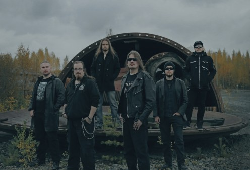 A band photo of Catamenia. Guitarist and founder Riku Hopeakoski is third from the right.