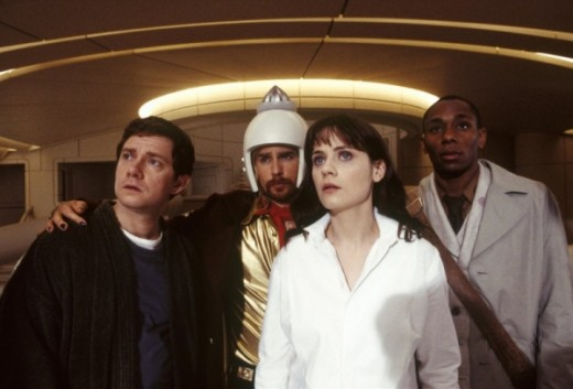 The main cast of the underrated 2005 Hitchhiker's film adaptation, left to right: Martin Freeman as Arthur Dent, Sam Rockwell as Zaphod Beeblebrox, Zooey Deschanel as Trillian, and Mos Def as Ford Prefect.