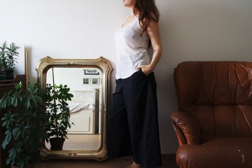 A student doing her best to practice with a propped mirror in her home.