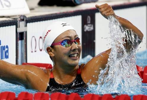 Swimmer Kanako Watanabe celebrates after winning the 200 meter breaststroke at the Swimming World Championships in Kazan, Russia.