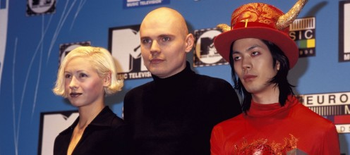 Three members of the band The Smashing Pumpkins at a promotional event in 1996. From left to right: D'arcy Wretzky, Billy Corgan and James Iha.