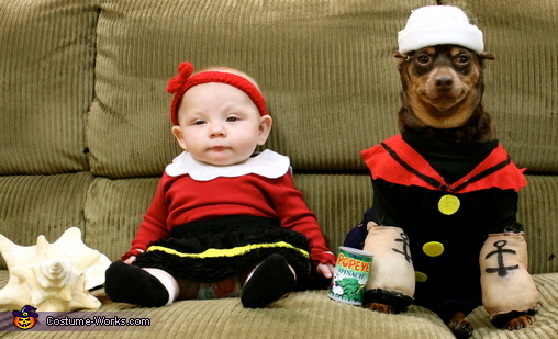 Popeye and Olive Oyl are great costumes for a human couple to dress in, but when you combine a baby Olive Oyl with a canine Popeye, it becomes the most talked about costume of the year.