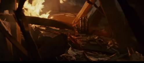 Luke's mechanized hand in the rubble.