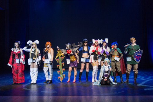 A group of cosplayers on stage at Yukicon 2014 convention in Finland.