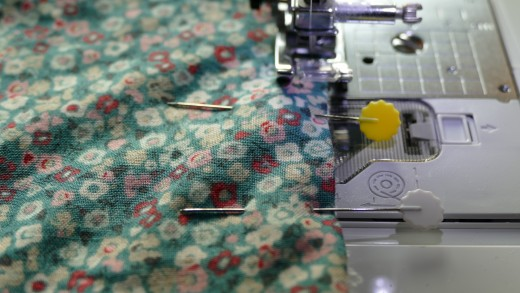 Using a 1/4 or a 1/8 inch seam allowance, start at the edge where the opening has been pinned together, back-stitch, and work around the whole of the pattern.