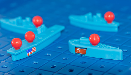 A collision on a toy Board battleship North Korean submarine and a us aircraft carrier.