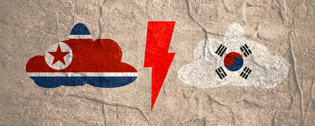 Image relative to politic situation between South Korea and North Korea. National flags on clouds divided by lighting. Grunge distress texture.