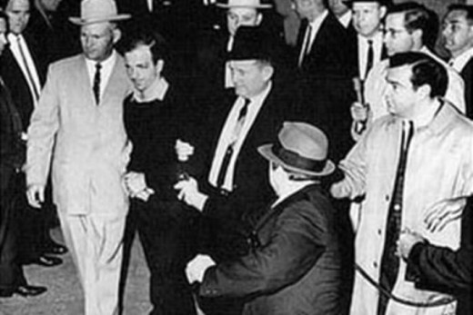 Jack Ruby shown murdering alleged assassin Lee Harvey Oswald at Dallas Police station.