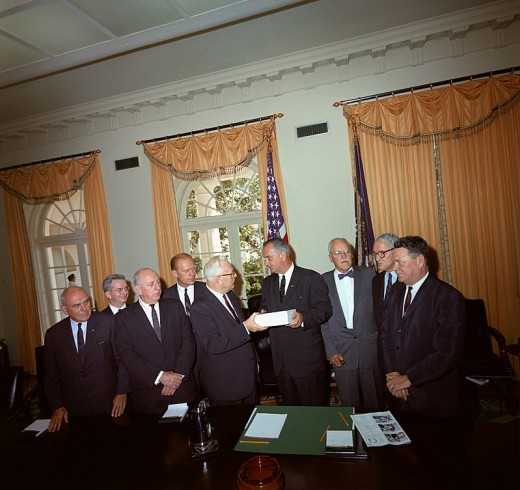 Members of the Warren Commission present their report on the assassination of President John F. Kennedy to President Lyndon Johnson. Cabinet Room, White House, Washington DC. L-R: John McCloy, J. Lee Rankin (General Counsel), Senator Richard Russell,