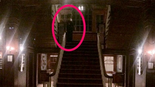 This Image, Captured by a Hotel Guest, is Purported to Show the Ghost of a Woman in a Black Dress, at the Top of the Stairs in the Stanley Hotel.