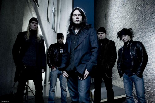 Vocalist Jami Pietila is at the center of the photo. Bassist Timo Lehtinen is at the far left.
