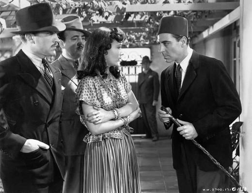 L. to R. : Unidentified, Gino Corrado, Sigrid Gurie & Joseph Calleia in Algiers