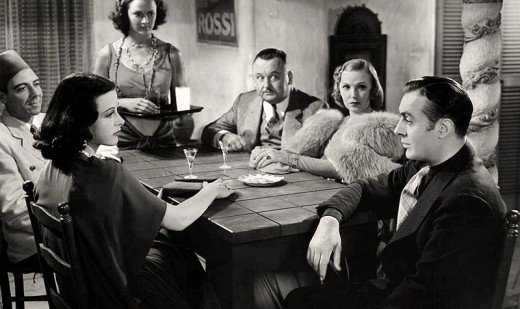 L. to R. (seated): Joseph Calleia, Hedy Lamarr, Bert Roach, Claudia Dell & Charles Boyer