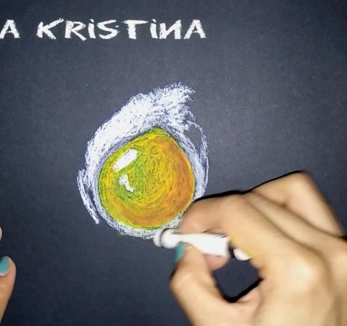 """6. Blend the white and black oil pastels to make  the egg yolk look """"embossed""""."""