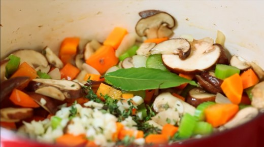 Later, add the stock, rice, thyme and bay leaves.