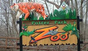 Potter Park Zoo entrance- a great adventure awaits.  Part of River Trail is visible in background
