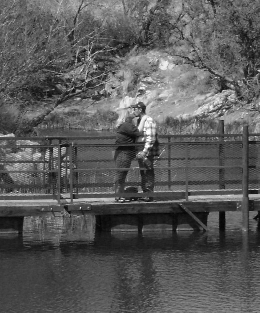 Kissing on a bridge