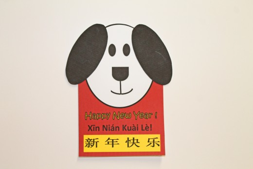 Sample Oval Dog Card.  The ears are on a template below. Color them, cut them out, and attach them to the dog's head.