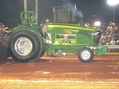 John Deere pulling tractor.