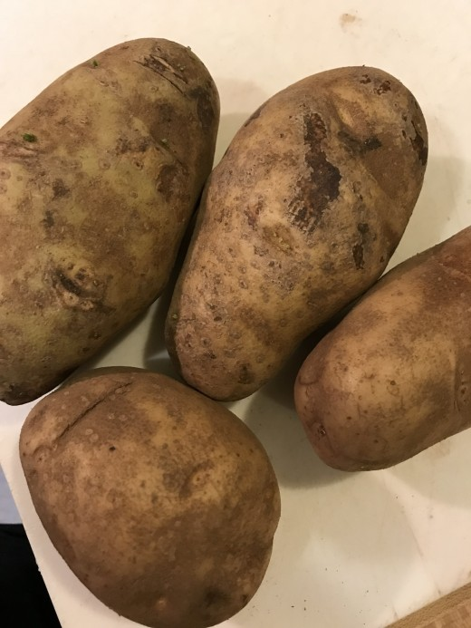 I like Russet potatoes for this. They are starchier, so they fluff up more when mashed. Yukon Golds or red potatoes will work, especially Yukons, but I simply prefer the Russets.
