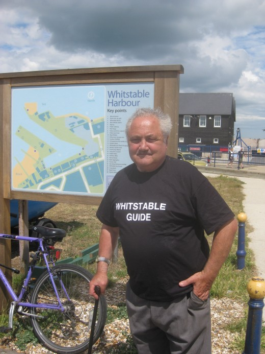 Frank Schofield in his customary spot in front of the Whitstable Town map near the Harbour.