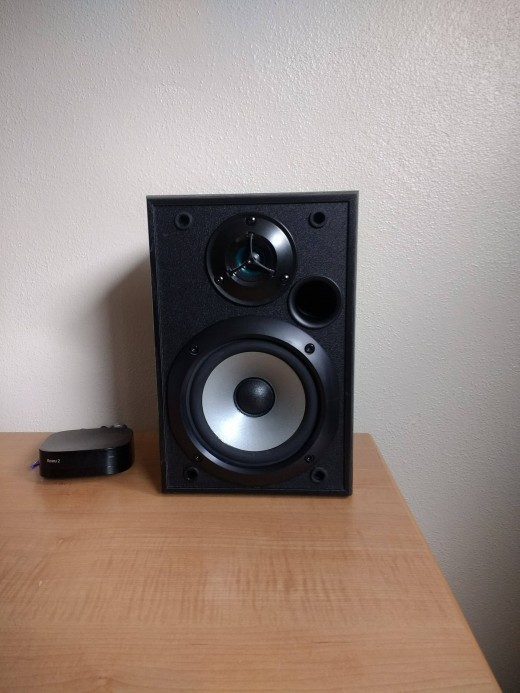 "One of the Sony SS-B1000 speakers in my ""man cave"", alongside a Roku box, and with the dust cover removed. I am a big fan of these speakers, they offer excellent value for money in my opinion. They fill my room with some pretty high fidelity audio."