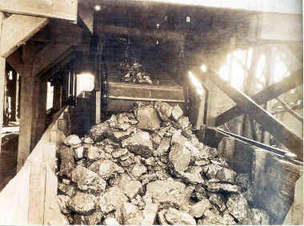 The three coal cars sliced the electric cable of the tipple which sparked a fire with the coal dust and the gas in the surrounding mine opening.