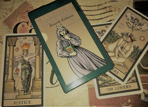The box, the two Lovers cards and Justice