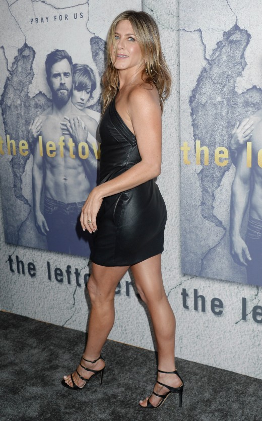 Jennifer Aniston in a one shoulder little black mini dress