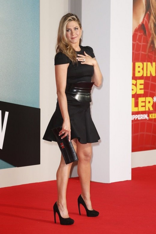 Jennifer Aniston in a little black skater dress and platform pumps