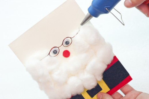 Cut your wire glasses when you are done making them and glue them onto your Santa card.