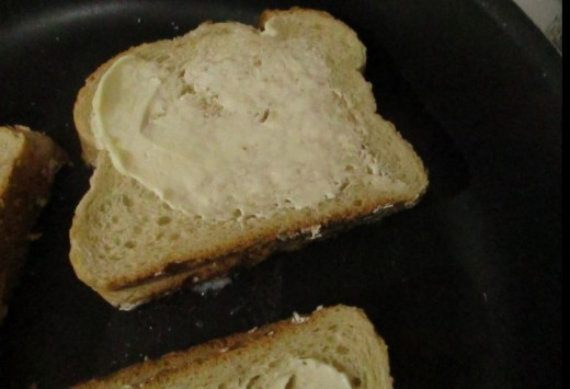 coat outside of sandwich with butter