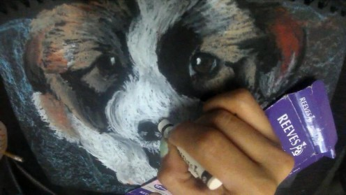 6. Get your white oil pastel again and go back to the previous strokes that you did on Step 1. This will add more details to your puppy drawing.