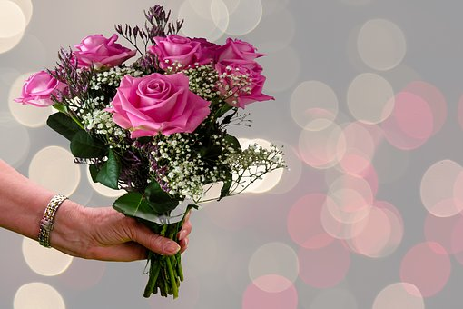 Roses on Valentines Day.  Pink Roses indicate Sweetheart.