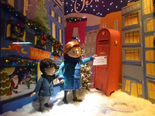 Many merchants go all out with their Christmas displays, like this window at Macy's in NYC