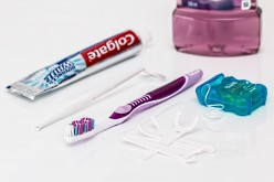 What Comes First Flossing or Brushing Your Teeth?