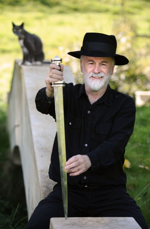 Sir Terry Pratchett and his awesome sword, featuring a cat.