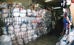 "Bundles of used clothing ready for export by ""The Attic"" Co.  (Photo credit, The Attic)"