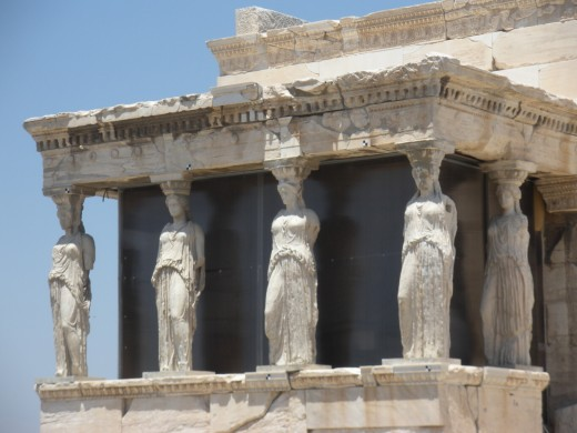 The Erechtheion. According to myth, Athena and Poseidon battled for patronage of Athens right there!  The design unites separate temples to each of the two gods.