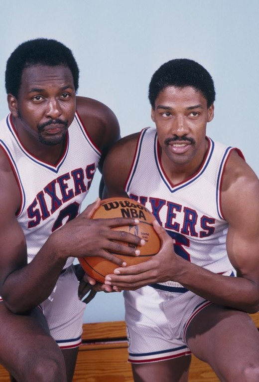 Moses Malone (left) had significantly smaller hands than Julius Erving despite Malone standing 4 inches taller than Erving.