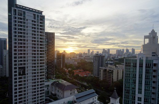 Watching the sun rise in Singapore from a 17th Floor Apartment