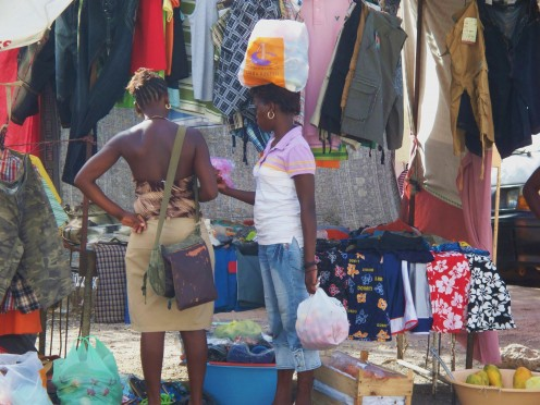 A West African market spreads over many streets and supplies fresh vegetables, clothing, and household items.