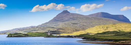 Ardvreck Castle by Loch Assynt, with Ben More behind
