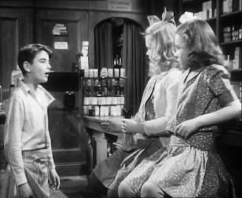 George in Mr. Gower's drugstore with Violet and Mary.