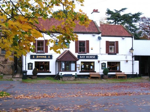 The Bay Horse by the roadside on Low Green, popular in WWII with nearby RAF personnel - there was a camp at the southern end of the High Street