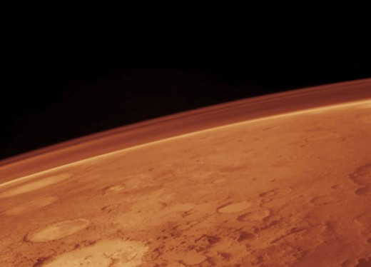 The atmospheric pressure on Mars is orders of magnitude lower than on Earth, and the composition is not breathable for humans.