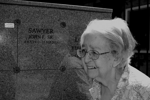 Grieving woman at her husband's grave.