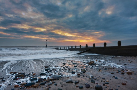Hornsea beach at dawn, with one of the 'groins' that prevents the sands from shifting along the coast with the strong shore currents