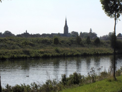 Bousbecque and Eglise Saint Martin, as seen from the Belgian side of the Lys/Leie river. Nord, Nord-Pas-de-Calais, France.