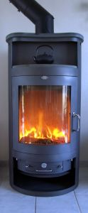 Fireplaces tend to be efficient in short uses for relatively small areas (or very small houses), unless plumbed into the entire HVAC system of the house.